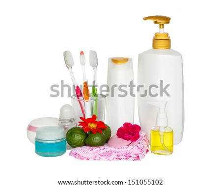 cosmetics bottles with towels and flower - stock photo