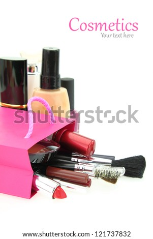 Cosmetics come out from a shopping bag - stock photo