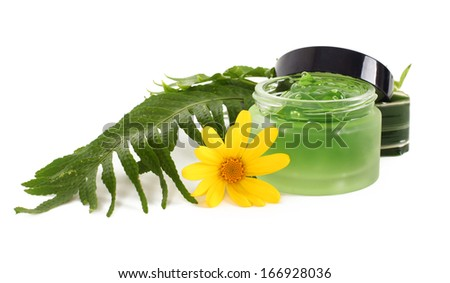 Cosmetics cream in the green jar on white background - stock photo