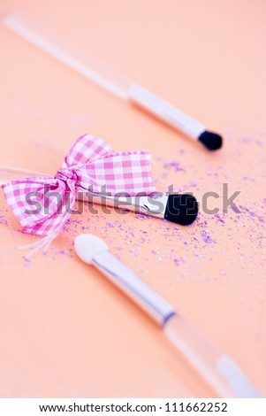 cosmetics essentials: eyeshadow & brush - stock photo