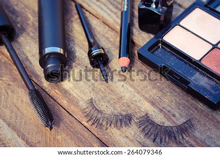 Cosmetics for eyes: pencil, mascara, eyeliner, false eyelashes  - stock photo