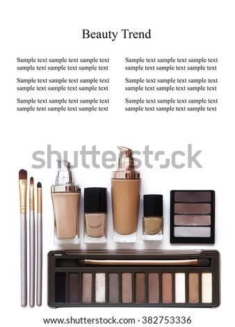 Cosmetics in natural colors and brushes isolated on white background. Makeup tools and accessories. Brow eyeshadows, naturel skin foundation for clean ton on face, nail polish, make-up brushes  - stock photo