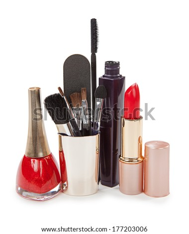 Cosmetics isolated on a white background. Lipstick, nail polish and mascara for the eyes. - stock photo