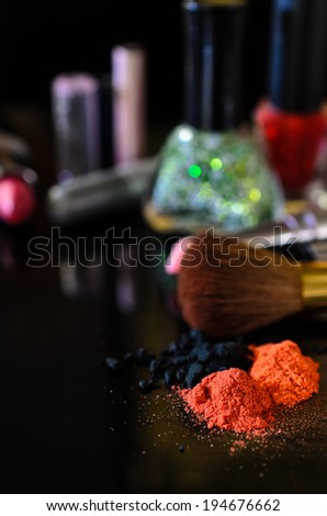 cosmetics isolated on black background - stock photo