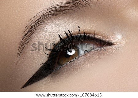 Cosmetics & make-up. Beautiful female eye with black liner makeup