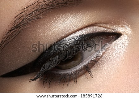 Cosmetics & make-up. Beautiful female eye with black liner makeup  - stock photo