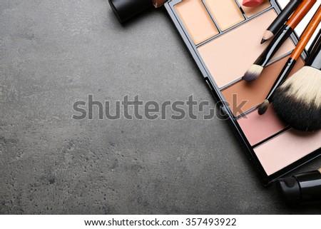 Cosmetics on dark background - stock photo