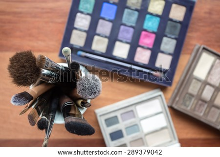 Cosmetics on wooden background. Photo is vintage style. - stock photo