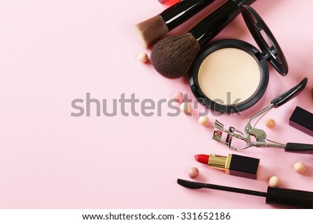 cosmetics set for make-up (face powder, lipstick, mascara brush) - stock photo