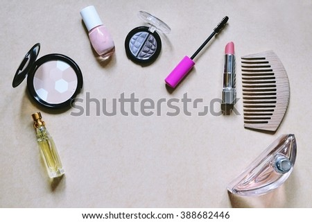 Cosmetics. Top view. Powder, lipstick, mascara, toilet water, eyeshadow. Flat lay. Top view - stock photo