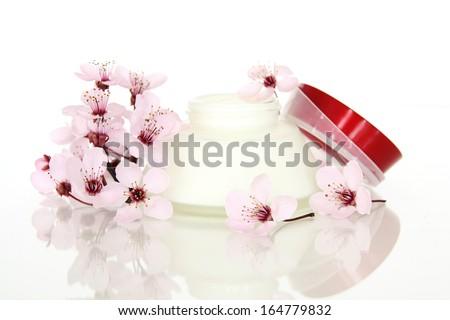 Cosmetics with sakura flowers - stock photo