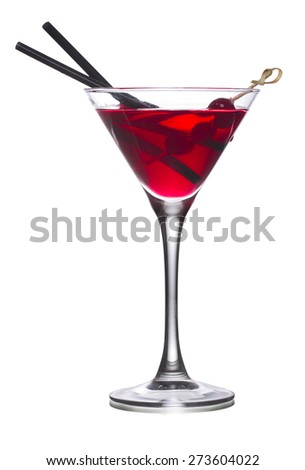 Cosmopolitan alcoholic cocktail decorated with black olives on a wooden skewer and black straws - stock photo