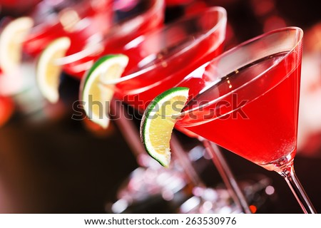 Cosmopolitan cocktail  on a bar counter in a nightclub - stock photo