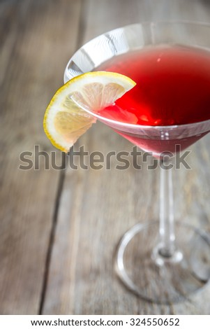 Cosmopolitan cocktail on the wooden background - stock photo