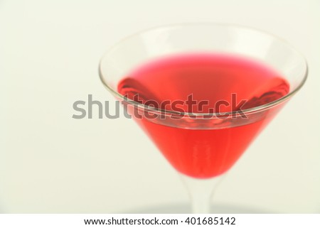 Cosmopolitan martini cocktail with vodka and red cranberry juice isolated on a white background