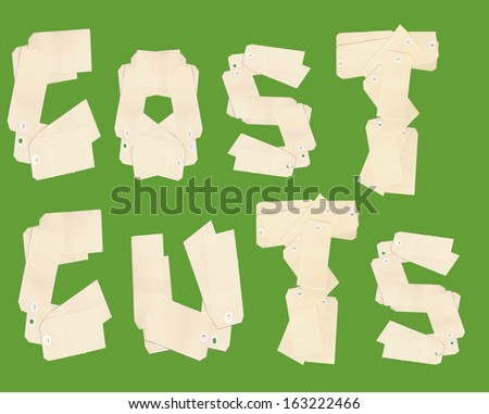Cost cuts letters made from price tags - stock photo
