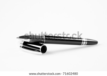 cost metal pen isolated on white , focus on the tip of pen