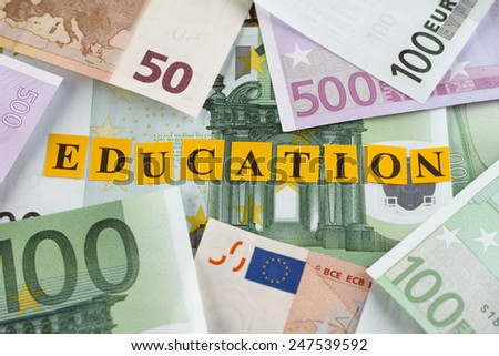 Cost of Education. Word Education on euro banknotes. - stock photo