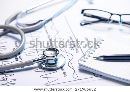 Cost of health care. Filling Medical Form, document, stethoscope - stock photo
