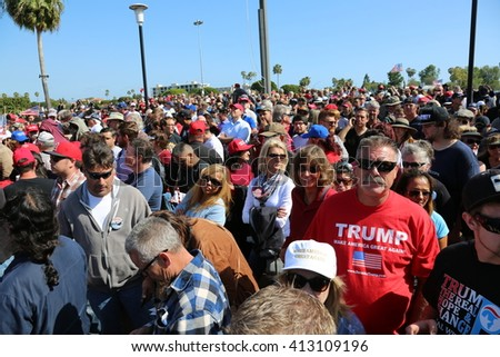 Costa Mesa, CA - April 28, 2016: Estimated 31,000 supporters of republican presidential candidate Donald Trump, cheer and wait patiently in line  to hear his speech at a rally at the Costa Mesa CA.