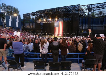 Costa Mesa, CA - April 28, 2016: Fish Eye Shots of supporters and protesters of republican presidential candidate Donald Trump, cheer and jeer while waiting to hear him speak in Costa Mesa CA.   - stock photo