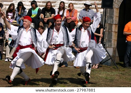 COSTA MESA, CA - APRIL 4 : Greek Syrtaki Folk Dance Ensemble of Orange County perform at the Anatolian Cultures and Food Festival at the Orange Country Fair Grounds April 4, 2009 in Costa Mesa, CA. - stock photo