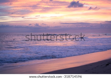 Costa Rica, Playa Santa Teresa beach at sunset, with surfers and waves. Paceful outdoor scene - stock photo