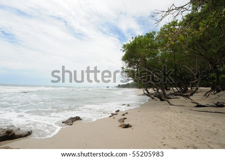 Costa Rica Tropical Beach and Coastline with Waves washing ashore - stock photo