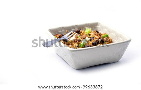 Costa Rican Black beans, rice, onion, and hamburger in square bowl on white - stock photo