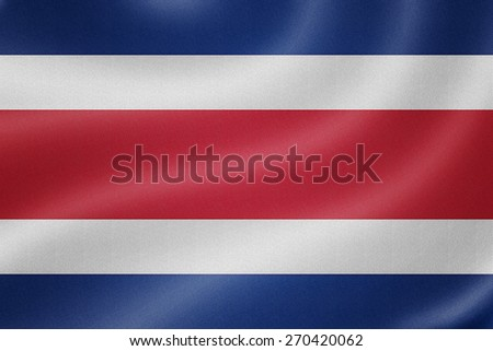 CostaRica flag on the fabric texture background - stock photo