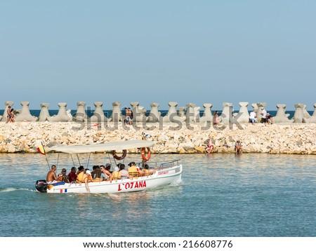 COSTINESTI, ROMANIA - JULY 30, 2014: People Boat Trip On The Black Sea In Costinesti Holiday Resort. - stock photo