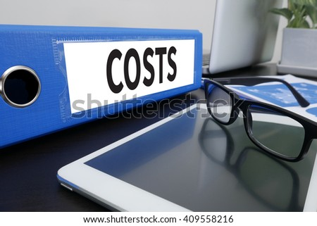 COSTS Concept  Office folder on Desktop on table with Office Supplies. ipad - stock photo
