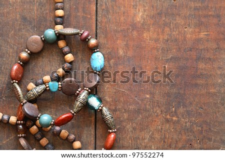 Costume Jewelry. Vintage female bracelets and necklace on wooden surface