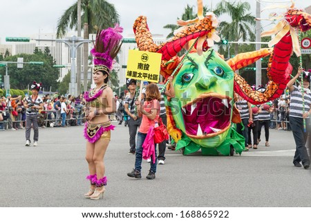 Costumed revelers march with floats in the annual Dream Parade on October 19, 2013, in Taipei, Taiwan.