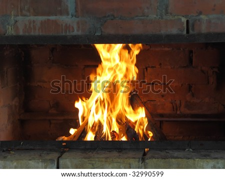 Cosy fireplace. - stock photo
