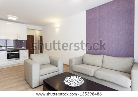 Cosy flat - grey sofa in white and violet living room - stock photo