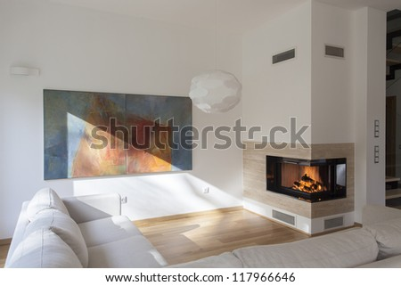 Cosy living room with original painting on wall - stock photo