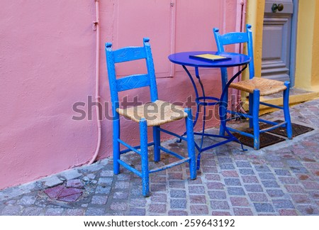 cosy street with colorful chairs, Chania old town, Crete, Greece - stock photo
