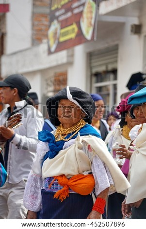 COTACACHI, ECUADOR - JULY 1, 2016: Women parade on the last day of Inti Raymi, he Quechua solstice celebration.  Women stomp and dance to awaken and soothe Mother Earth.