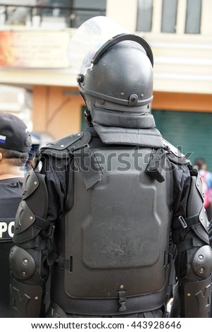 COTACACHI, ECUADOR - JUNE 25, 2016: Inti Raymi, the Quechua solstice celebration, with a history of being violent in Cotacachi.  Riot police surround the square in case of violence.