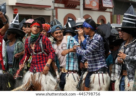 "COTACACHI, ECUADOR - JUNE 29, 2016: Inti Raymi, the Quechua solstice celebration, with a history of violence in Cotacachi.  Group of men charge forward to ""take the square."""