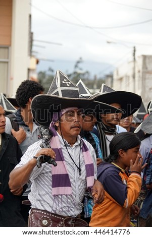 COTACACHI, ECUADOR - JUNE 30, 2016: Inti Raymi, the Quechua solstice celebration, with a history of violence in Cotacachi.  Costumed men stomp and dance to awaken Mother Earth.