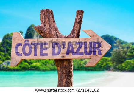 Cote D'Azur wooden sign with beach background - stock photo
