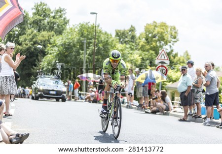 COTE DE COULOUNIEIX-CHAMIERS,FRANCE - JULY 26: Marco Marcato (Cannondale Team) pedaling  on a steep slope,during the stage 20 (time trial Bergerac - Perigueux) of Le Tour de France on July 26, 2014  - stock photo