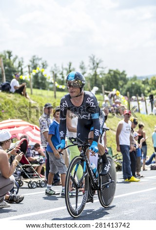 COTE DE COULOUNIEIX-CHAMIERS,FRANCE - JULY 26:Vasili Kiryienka (Team Sky) pedaling  on a steep slope,during the stage 20 ( time trial Bergerac - Perigueux) of Le Tour de France on July 26, 2014  - stock photo