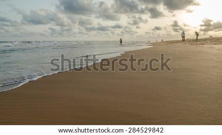 Cotonou, Benin - May 25: Local residents of Cotonou enjoy their Monday afternoon at Obama Beach on May 25, 2015 in Cotonou, Benin. - stock photo
