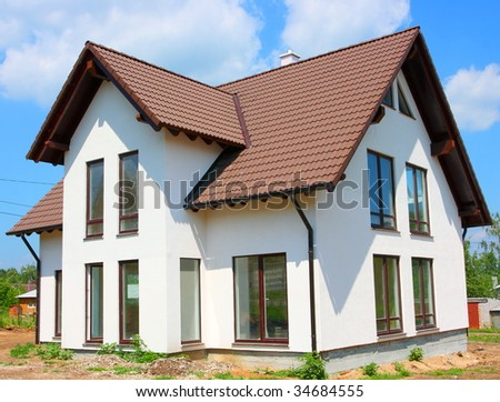 Cottage against a blue sky - stock photo
