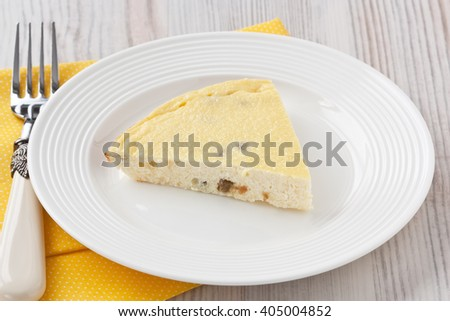 Cottage cheese casserole with raisins and semolina on wooden background/ Cottage cheese casserole  - stock photo