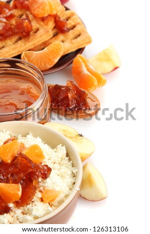 cottage cheese in bowl with homemade tangerine jam, isolated on white