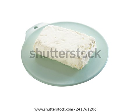 cottage cheese in plastic tray on white background - stock photo